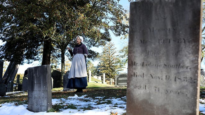 Mary Bryant, played by Wendy Bawabe, explains how she died  eight days after giving birth to twiins in 1724. She and her twins are buried in the oldest gravesite in the First Parish Cemetery in Norwell.