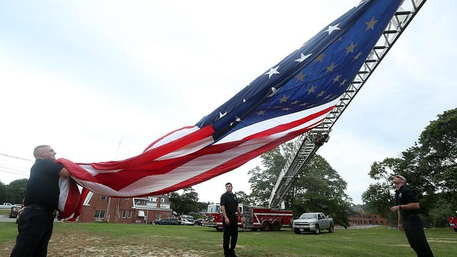 Marshfield Fire Department marks the 9/11 attacks on the World Trade Center with a ceremony at Marshfield Central Fire Station in 2019. Wicked Local file photo