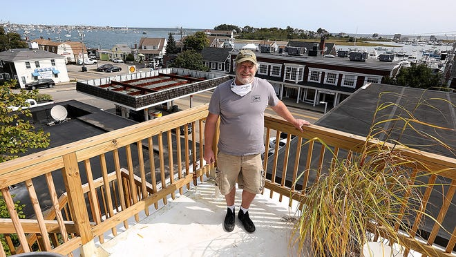 Joby Norton stands on his roof deck for the new Mullaney's Fish Market, where he will have a 20 person chef's table set up and a few garden beds to grow fresh vegetables to go along to-go meals that they will offer when it opens later in the year.