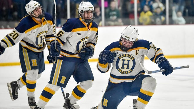 Connor Morris, right, of Hanover pumps his fist after scoring the first goal trailed by teammates Zach Taylor and Lucas Lanagan during their MIAA Division 3 state semifinals game win over Swampscott 5-0 at the Stoneham Arena on Wednesday, March 14, 2018.