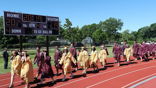 Weymouth High seniors make their way to their seats for the graduation ceremony at Weymouth High School on Saturday, June 8 2019. Wicked Local Staff Photo/Robin Chan