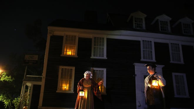 Thomas the inn keeper, played by Sam Groll, and his wife, Hannah, played by Bonnie Gardner, welcome guests to Old Ordinary which was originally a tavern when it was first built in 1686 during the Haunted Hingham Tour on Saturday, Oct. 17, 2020.
