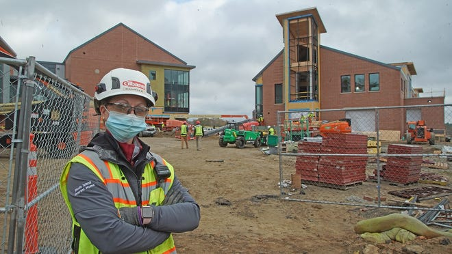 Taunton native Danielle Crafford, seen here on Thursday Nov. 5,  2020, is general superintendent for Gilbane Building Co. on the $104 million expansion project at Bristol County Agricultural High School in Dighton. Taunton Gazette | Mike Gay