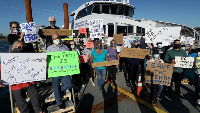 Protesters gather in front of the 2:00 ferry in Hingham to voice their displeasure at the proposed cuts to the service on Tuesday, Nov. 10, 2020.