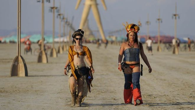 Two participants at the Burning Man festival in the Nevada desert on Monday August 25, 2014.