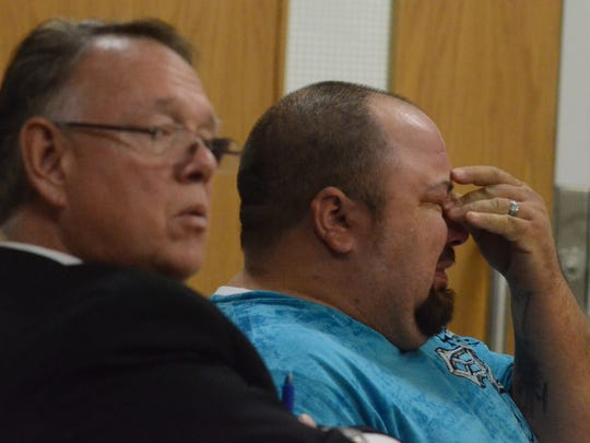 Robert Cato cries during his sentencing while sitting with his attorney, Timothy Tromp.