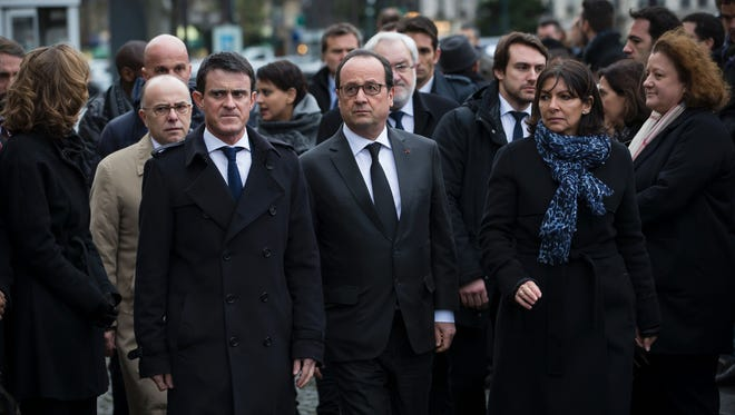 French President Francois Hollande (center), French Prime Minister Manuel Valls (left) and Mayor of Paris Anne Hidalgo (right) arrive to unveil in Paris on Jan. 5, 2016 a commemorative plaque outside the Hyper Cacher, a kosher supermarket, during a ceremony to pay tribute to the victims of the attack on the supermarket on January 9, 2015.