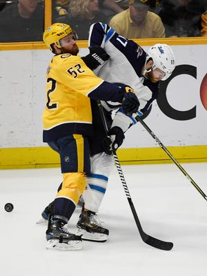 Nashville Predators defenseman Matt Irwin and Winnipeg Jets center Adam Lowry battle during the first period of Game 5 of last season's playoff series.