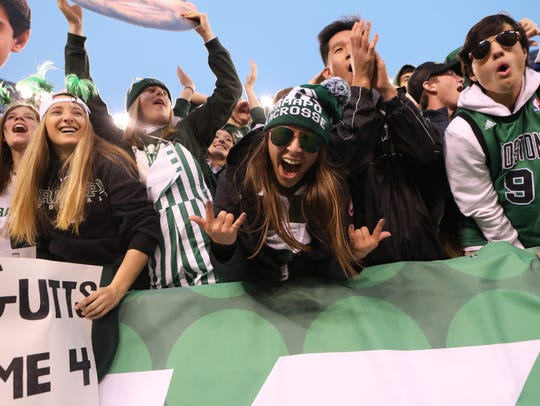 Ramapo football fans cheer their players after their