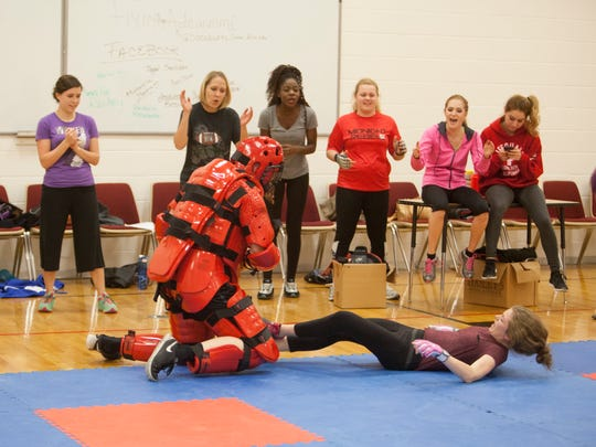 Dixie State students and members of the community participate in a women's self-defense class Wednesday, Dec. 9, 2015.