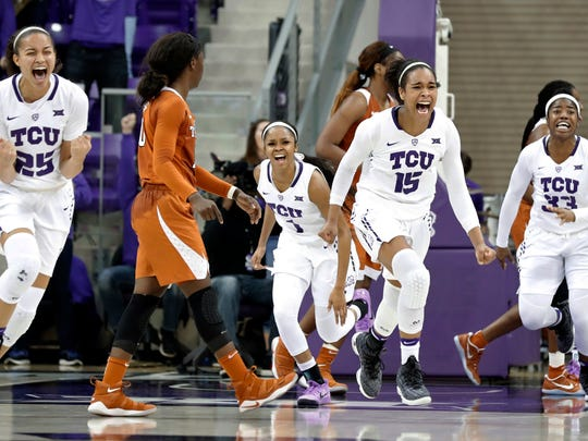 TCU's Kianna Ray (25), Toree Thompson (1), Jayde Woods (15) and Adeola Akomolafe (33) celebrate the team's 79-77 win over Texas in an NCAA college basketball game Jan. 10 in Fort Worth.