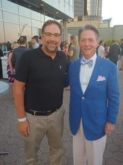 Leaders for Kids board member Peter Ginopolis, left,