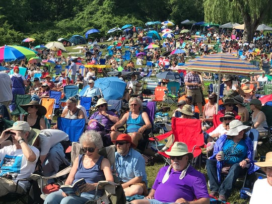 Crowds of festival goers listen to music from the Rainbow Stage at the Clearwater Great Hudson River Revival, June 15, 2018.