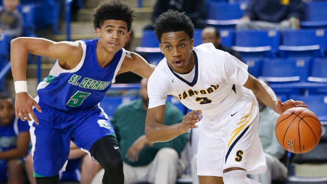 Sanford's Mikey Dixon drives past St. Georges' Mark Harris in the first half of the DIAA state tournament Saturday at the Bob Carpenter Center.