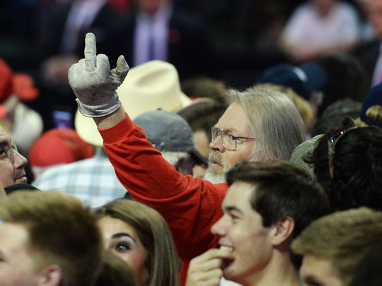 A man flips off the media at a Donald Trump rally at the Budweiser Event Center in Loveland on October 3, 2016.