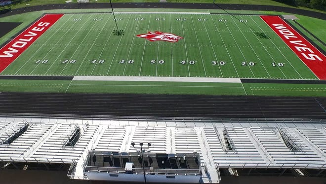 An aerial photograph shows what used to be the turf at University of Cincinnati installed at Reeds Spring High School and made over for the Wolves.