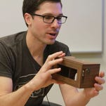 Clay Bavor, shown here with a wooden version of Google Cardboard, is spearheading the company's virtual reality efforts, which reports say will include a high-end goggle that doesn't need to be tethered to a computer.