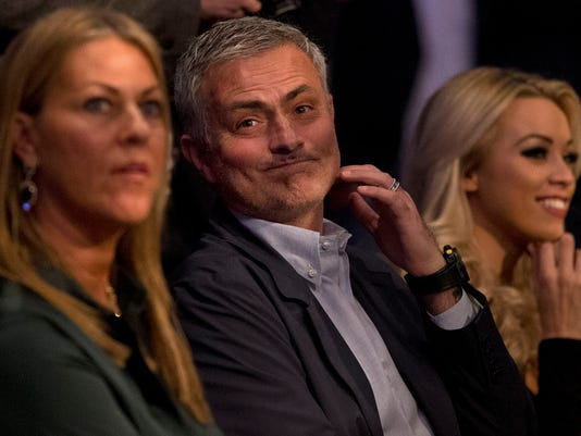 Former Chelsea football team manager Jose Mourinho waits for the start of the IBF heavyweight title bout between British boxer Anthony Joshua and US boxer Charles Martin at the O2 Arena in London, Saturday, April 9, 2016.(AP Photo/Matt Dunham)