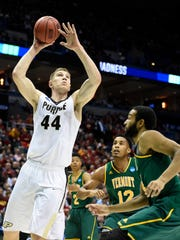 Isaac Haas (44) goes up for a shot against the Vermont