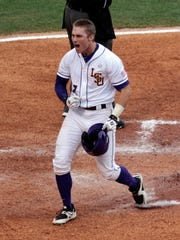 LSU's Jared Foster celebrates as he crosses home plate after hitting a home run during the second inning against Auburn in a Southeastern Conference college baseball tournament game Wednesday.