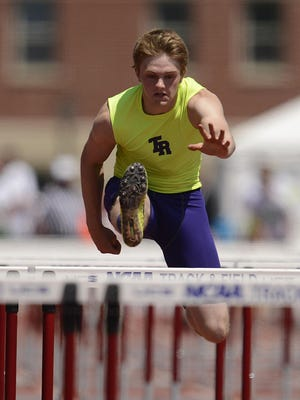 Two Rivers' Ethan Willman clears a hurdle while competing in the Division 2 110-meter hurdles on Saturday.