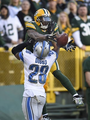 Green Bay Packers receiver Davante Adams (17) tries to make a catch over Detroit Lions cornerback Quandre Diggs (28) in the fourth quarter during Sunday's game against the Detroit Lions at Lambeau Field.