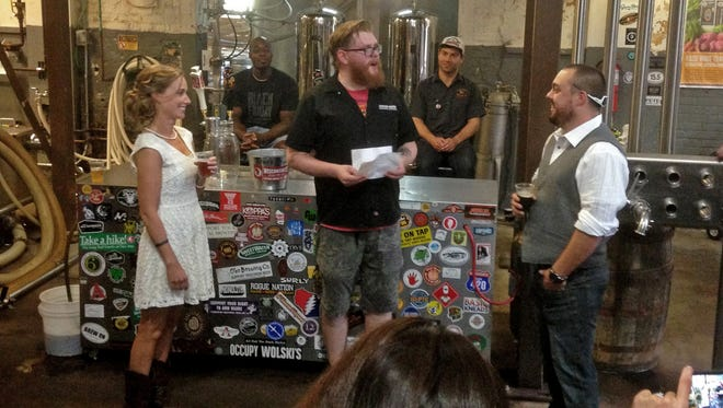 Lakefront Brewery tour guide Josh Barto officiated the wedding of Adam and Kelly Fifer during the first Valentine's Day weddings special at the brewery last year. This year, 10 couples have reserved their spot for a free wedding at the brewery on Feb. 14. Ten more will renew their vows.