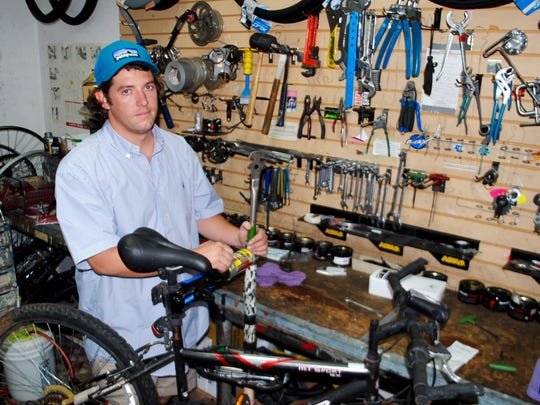 With four years working at Ride On Sports, Tyler Wright uses specialized tools in the repair and tuneup of bicycles brought in by causal riders as well as serious enthusiasts.