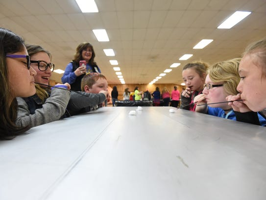 Pinkston Middle School students use straws to blow