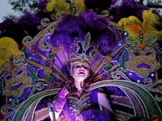 A maid from the royal court of Endymion throws beads