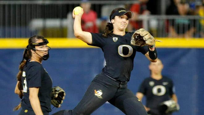 Oregon's Lauren Lindvall (8) throws back to first but is unable to get the out against LSU in the first inning of a Women's College World Series softball game in Oklahoma City, Saturday, June 3, 2017. (Bryan Terry/The Oklahoman via AP)