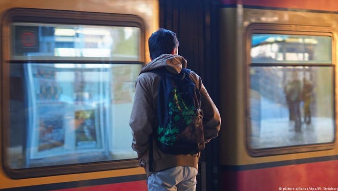 A young man waits for a subway train in Berlin.
