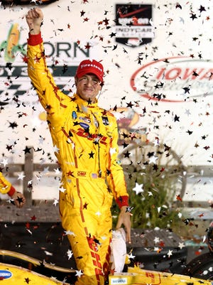 Ryan Hunter-Reay ccelebrates his win in the Indy Car series event in Newton, Iowa.