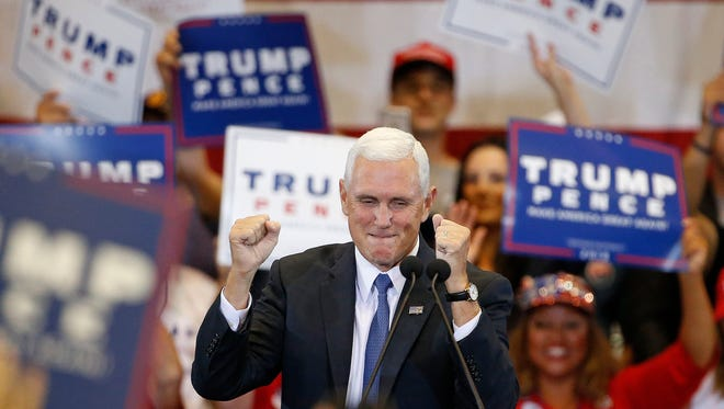 Gov. Mike Pence, Donald Trump's running mate, cheers along with the crowd prior to speaking at a campaign rally Tuesday.