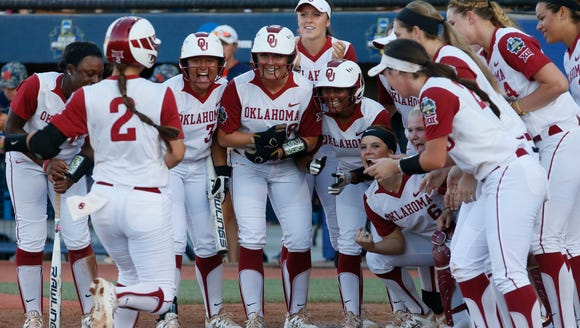 Oklahoma's Sydney Romero (2) is greeted at home plate