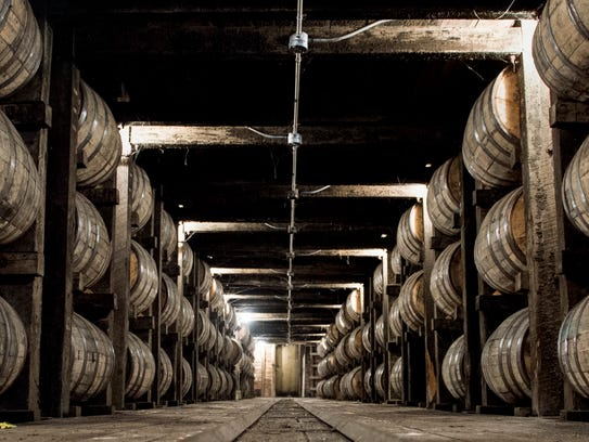 Barrels of whiskey age in a barrelhouse at the Jack