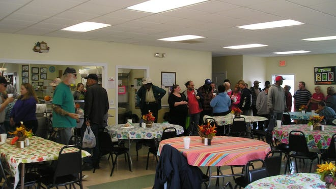Patrons line up Tuesday to start through the serving line at the Our Daily Bread soup kitchen on Jordon Street in Seneca. Most get their midday meal at the kitchen every weekday.