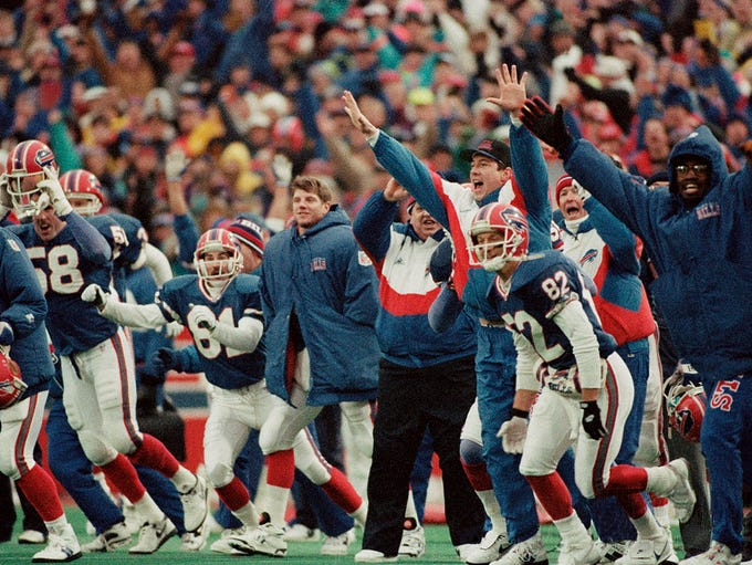 Receiver Don Beebe (82) and an injured quarterback
