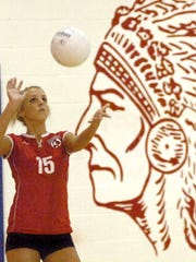 Talawanda No. 15 Maggie Johnson serves the ball in a 2009 game against Norwood High School.