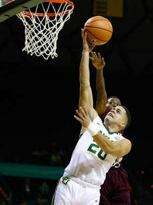 Baylor Bears guard Manu Lecomte (20) goes to the basket on Texas Southern Tigers guard Demontrae Jefferson (3) during the first half at Ferrell Center.