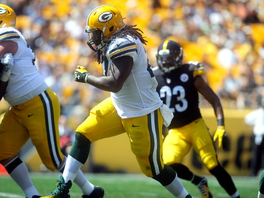 CORRECTS DAY OF THE WEEK TO SUNDAY - Green Bay Packers running back Eddie Lacy (27) runs past Pittsburgh Steelers free safety Mike Mitchell (23) for a touchdown in the first quarter of the pre-seaon NFL football game, Sunday, Aug. 23, 2014 in Pittsburgh. (AP Photo/Vincent Pugliese)