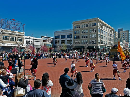 The Central High School Kilties perform at Park Central Square during an event celebrating the 90th anniversary of the Drum & Bugle Corps held at Park Central Square and Central High School in Springfield, Mo. on April 2, 2016.
