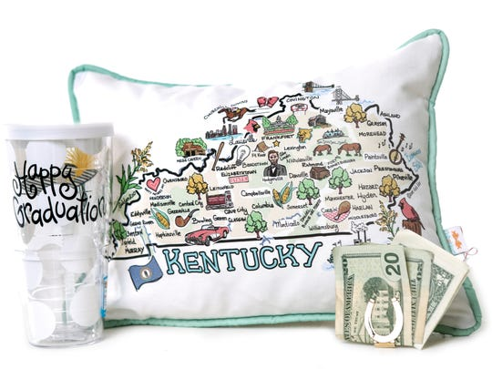 "Everyday pick-me-ups: Tervis grad cup, $28; Fish Kiss ""Kentucky"" pillow, $43; both at Two Chicks and Company; Salisbury pewter horseshoe money clip, $30, at Claters jewelers."