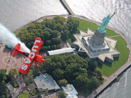 The Lucas Pitts biplane in action near the Statue of