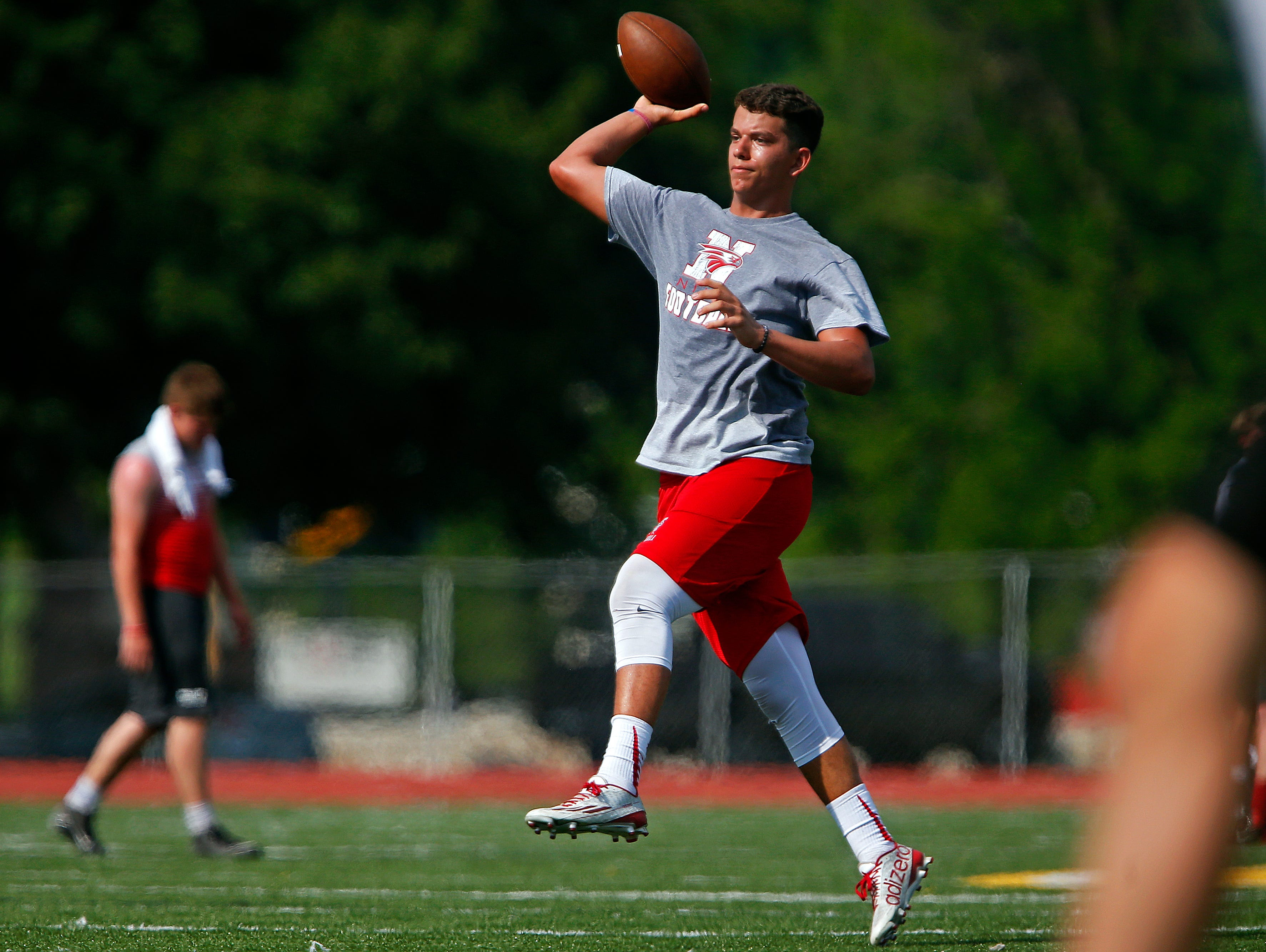 A Nixa High School player throws the ball as the Eagles played West Plains High School during the 2016 Parkview 7 on 7 Tournament held at JFK Stadium in Springfield, Mo. on June 16, 2016.
