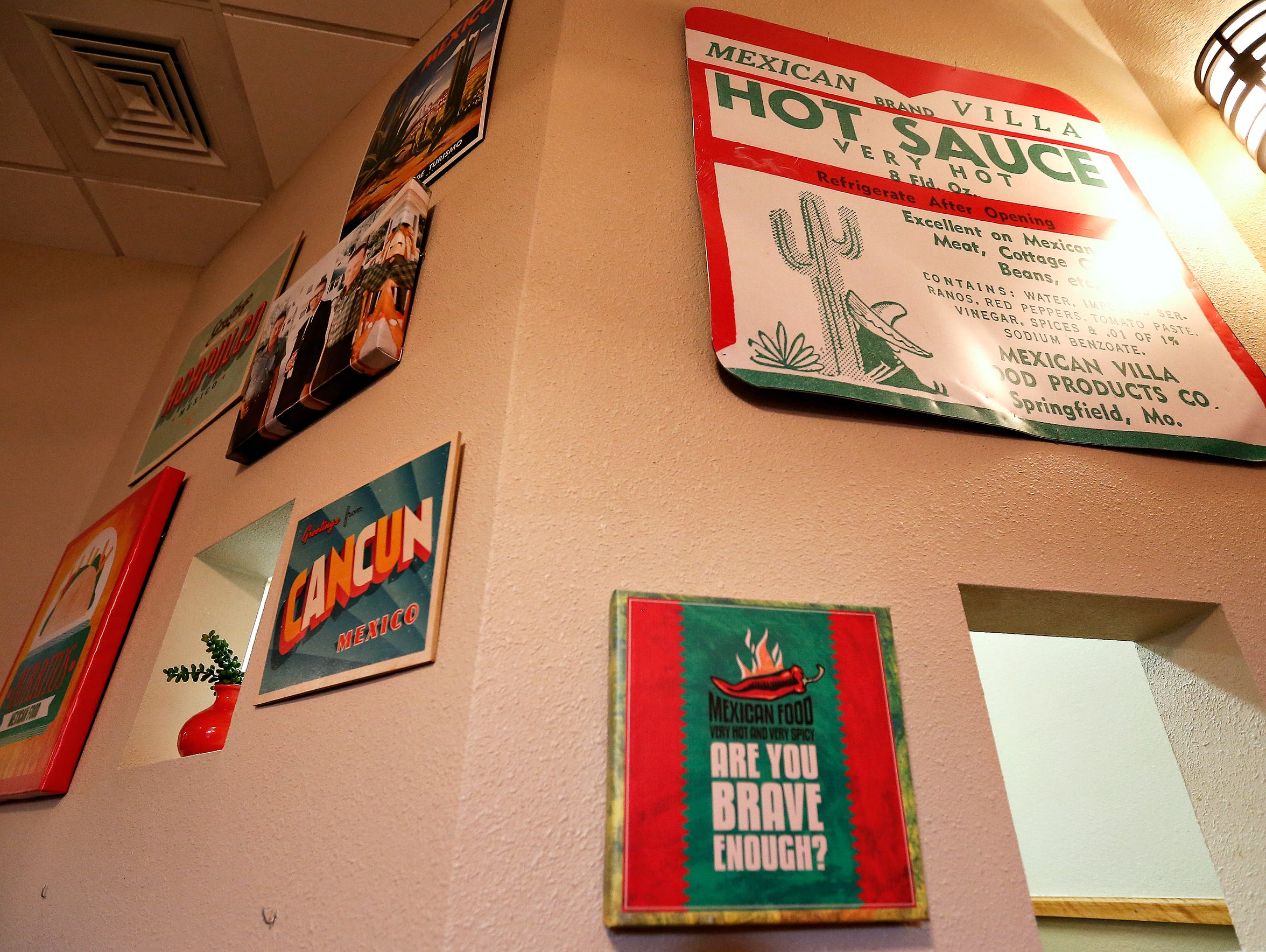 A sign bearing an enlarged version of Mexican Villa's