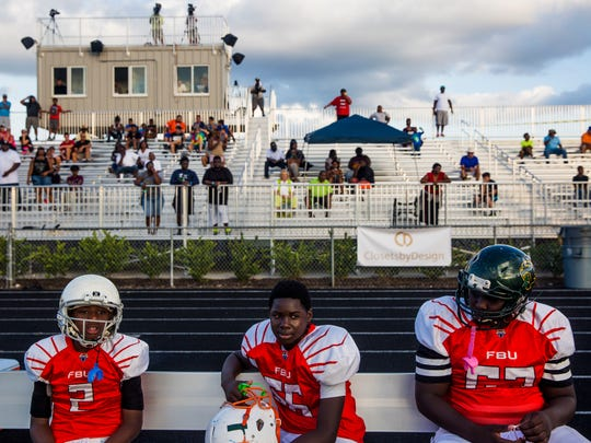 Broward players sit on the bench during the FBU National Championships for 7th grade at First Baptist Academy on Tuesday, Dec. 20, 2016. Broward won against Dallas Metro with a final score of 42-24.