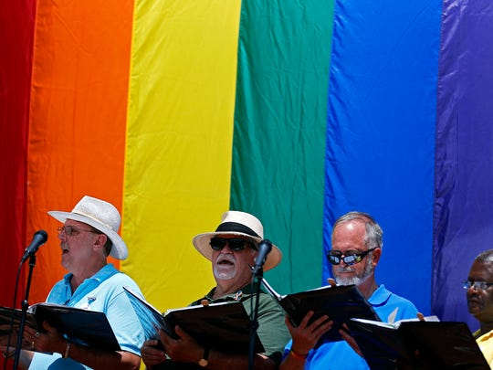 The Men's Chorus of the Ozarks performs during the 2016 Greater Ozarks Pridefest at Park Central Square in Springfield, Mo. on June 17, 2016.