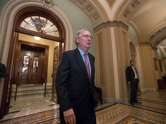 Majority Leader Mitch McConnell leaves the Senate chamber on Capitol Hill on July 27, 2017.