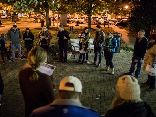 Members of Seeds Church gather in Murfreesboro town square on Wednesday night for a prayer vigil before the upcoming white nationalist rally, Oct. 25, 2017.